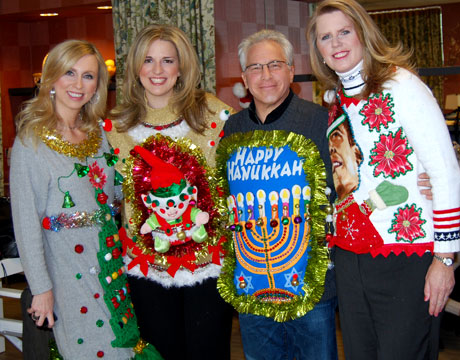 man in happy hanukkah ugly sweater and three women in ugly christmas sweaters at holiday party