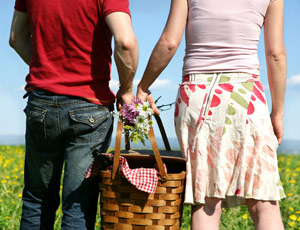 couple having a picnic with picnic basket